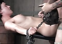 Chained up slut in stockings used as a sex slave