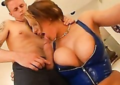 Skintight blue latex top on big tits babe