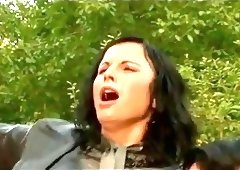 High Society Ladies dressed in Leather fucked in garden