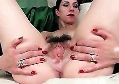 Under her pubic hair is a pierced clitoris