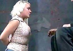 Busty blonde slave girl gives handjob while bound BDSM porn