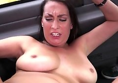 Hot woman is getting her pussy lips stretched in the back of a van