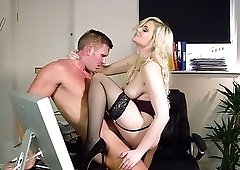Blondie in stockings jumps on a big boner of her boss