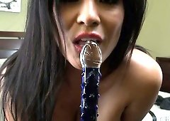 Alexis Amore savors the delicious taste on the dildo as it comes out of her cunt