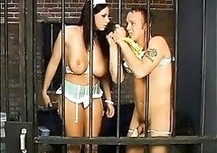 Tall lustful nurse Gianna Michaels humiliates a loser in the prison cell