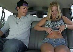 Blonde is having fun in her car
