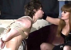 Sexy mistress threatens to cut bound guy