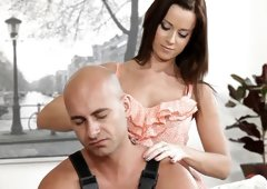 A brunette with large tits is giving a guy a massage and then she fucks
