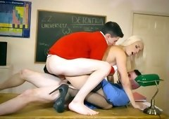 Blonde teacher fucked hard by two of her horny students
