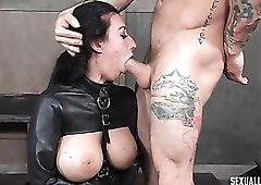 Sexy leather straitjacket on a slave slut