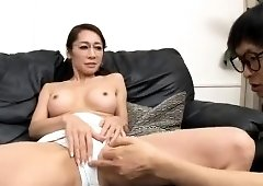 Slender Oriental wife with big boobs takes a deep pounding