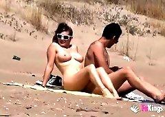 Nasty babe fucks a guy in a beach curvaceous of voyeurs