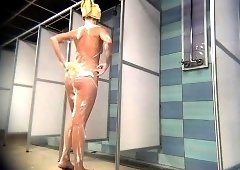 Slender girl with a lovely ass and hot legs takes a shower
