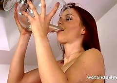This gorgeous skanky redhead has a pee fetish and she is always pee thirsty