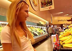 Exhibitionist teen fucks a vegetable in the grocery store