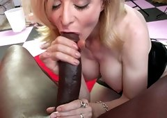 Mature blonde Nina Hartley gives great blowjob to big black dude
