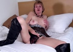 Cougar in leather boots uses her free time to play with the beaver