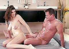 Michele James gets a big cock oiled up before she rides it