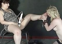 Blonde teen slave is used for her female master's pleasure