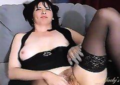 Black stockings make her milf legs look lovely