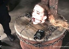 Poor submissive Jessica Kay is put into the wooden barrel and treated hard