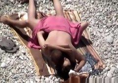 Couple secretly filmed in the rocky beach fucking