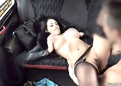 Huge tits babe in stockings fucks in cab