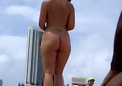 Exhibitionist wife teasing strangers at a nude beach