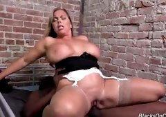 Pleasing towheaded mature lady Amber Lynn Bach receiving a cumshot