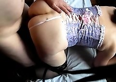 Fat momma in a sexy corset gets her shaven pussy worked out
