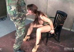 Tied up bitch Syren De Mer is face fucked by a duo of kinky soldiers