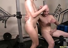 Lily gets fucked on a workout bench.