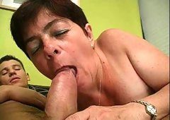 Short-haired mature bitch sucks a fat dick and takes a ride on it