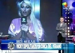 Wicked blonde shows off her curves on the live television