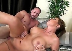 Extremely hot big-boobed MILF nicely nailed on the couch