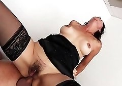 Hairy pussy brunette in black stockings riding doctor's cock