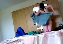 Wet woman dressing in bedroom